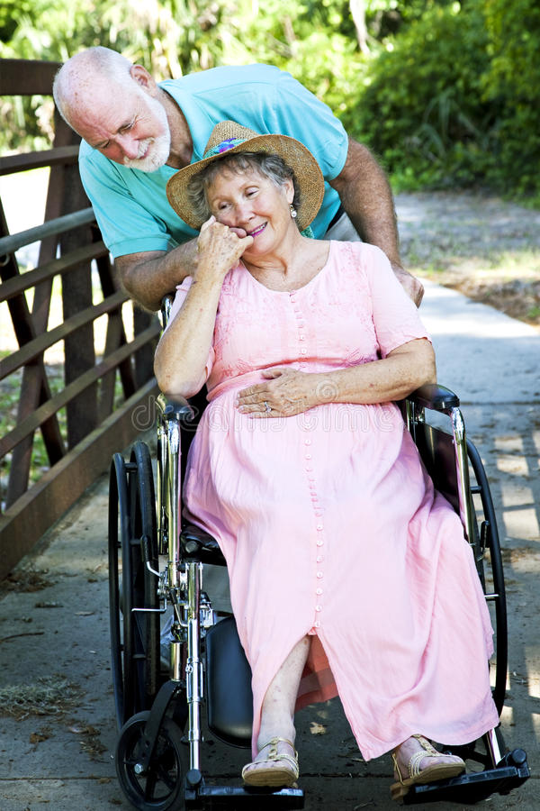 Caring for Disabled Wife royalty free stock photography