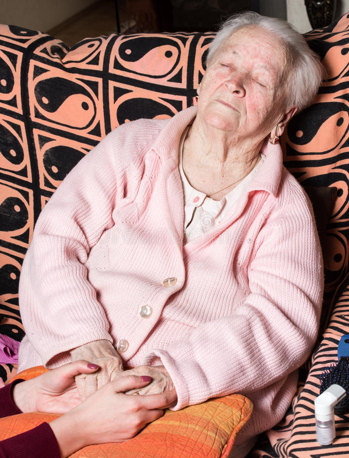 Caring hands holding old lady's hands royalty free stock photos