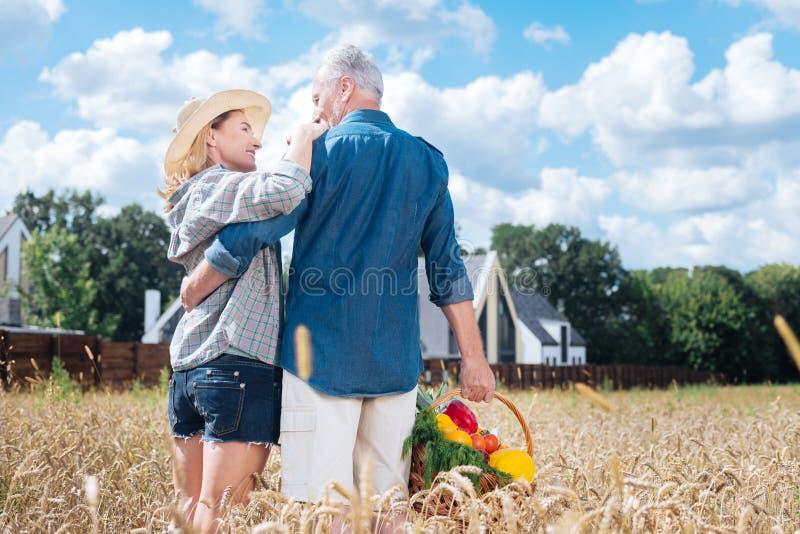 Caring loving man looking at his beautiful stylish beaming wife royalty free stock photos