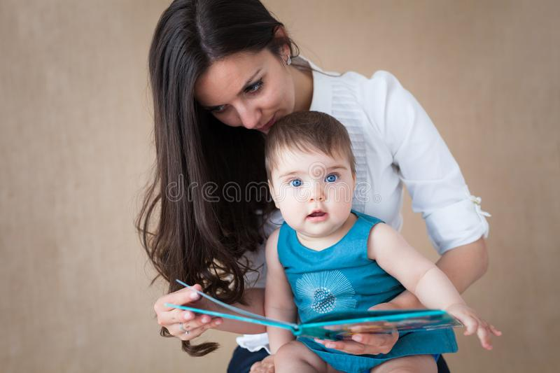Mother story-telling to her baby girl royalty free stock photos