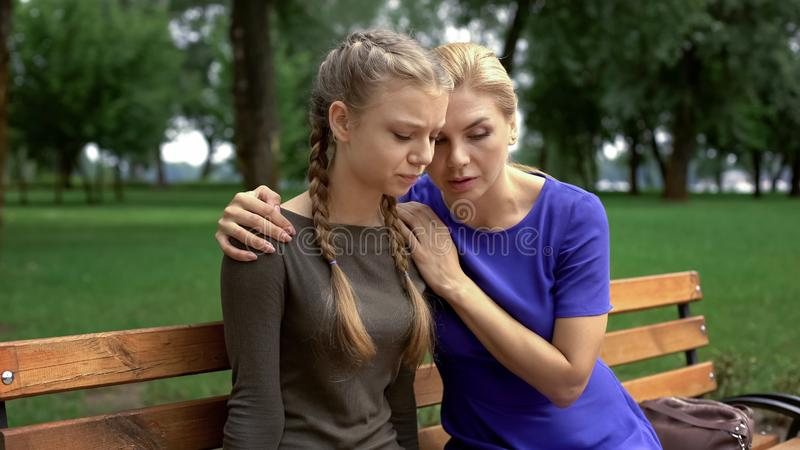 Caring mother supporting daughter, problems with first relationship, betrayal. Stock photo stock photo