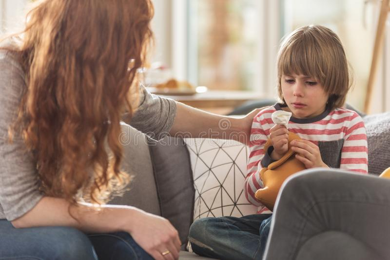 Caring mother supporting sick son stock photography