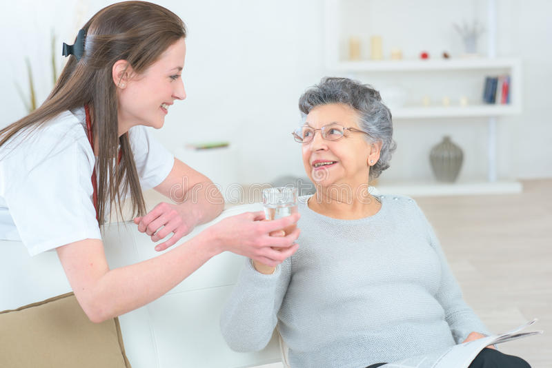 Caring nurse supporting patient. Caring nurse supporting her patient stock photos
