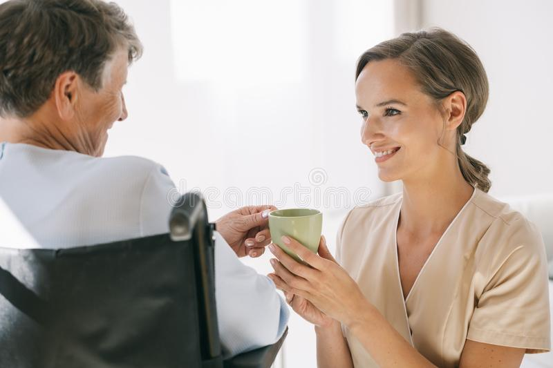 Caring nurse and a woman royalty free stock images