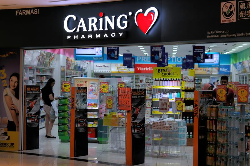 Caring Pharmacy Store In Malaysia. The exterior of Caring Pharmacy outlet at the Ipoh Parade shopping mall, Malaysia stock photo