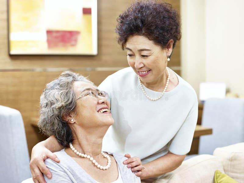 Caring senior asian women showing friendship stock photos