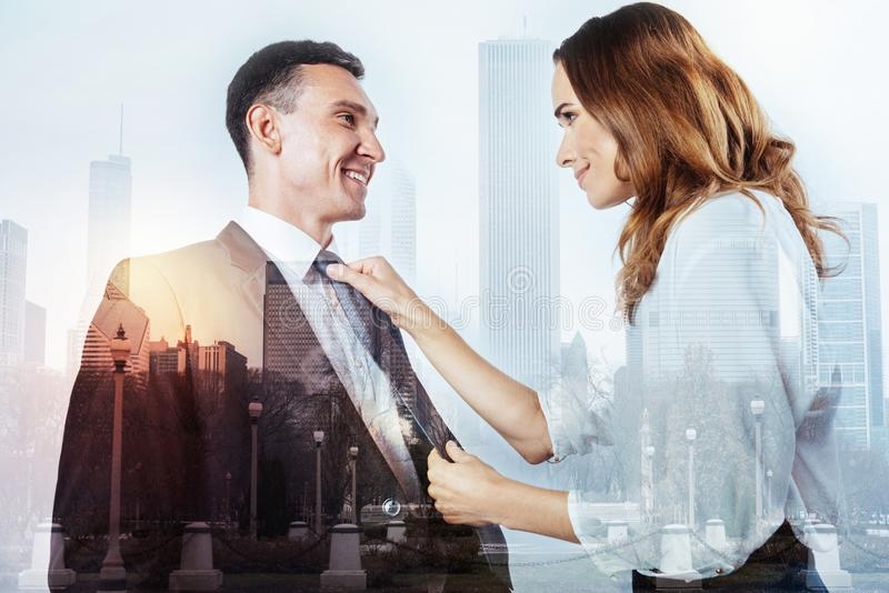 Kind woman helping her husband with his tie royalty free stock images