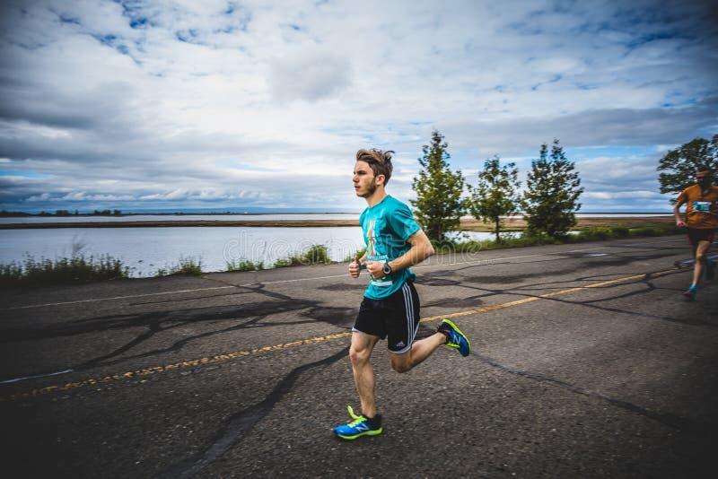 Man Marathoner Sprinting the last 500m before the Finish Line. CARLETON, CANADA - June 4, 2017. During the 5th Marathon of Carleton in Quebec, Canada. Man royalty free stock photo