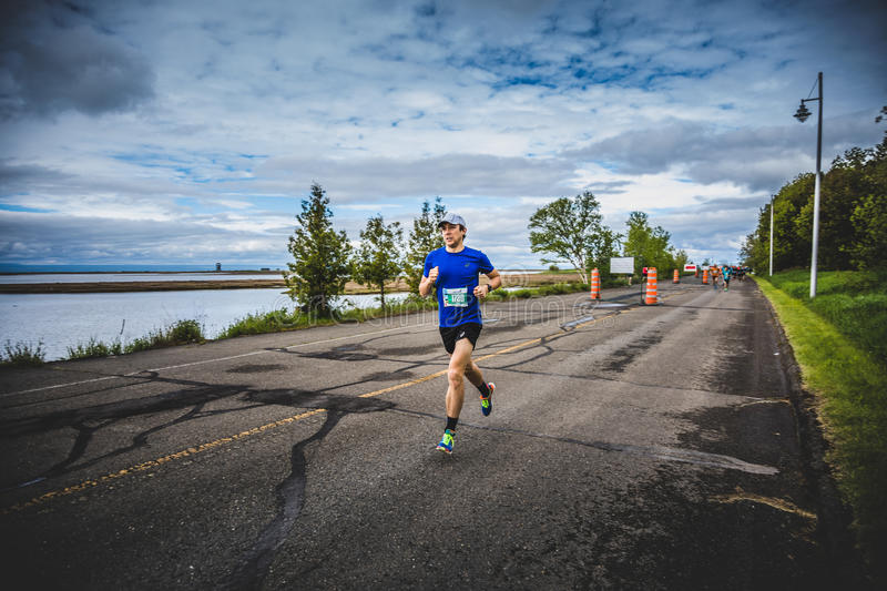 Man Marathoner Sprinting the last 500m before the Finish Line. CARLETON, CANADA - June 4, 2017. During the 5th Marathon of Carleton in Quebec, Canada. Man stock images