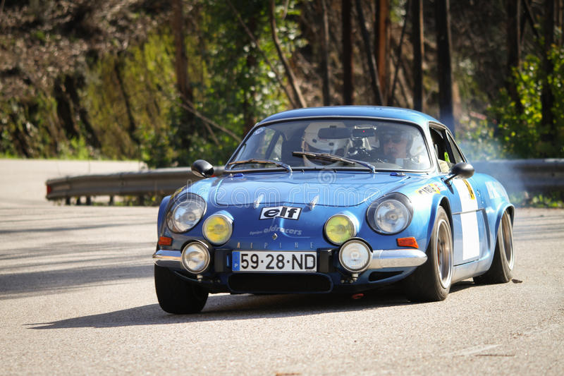 Carlos Brizido drives a Renault Alpine 1600. LEIRIA, PORTUGAL - FEBRUARY 2: Carlos Brizido drives a Renault Alpine 1600 during 2013 Amateur Winter Rally, in stock images