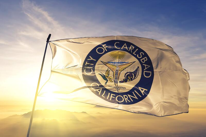 Carlsbad of California of United States flag waving on the top. Carlsbad of California of United States flag waving stock photos