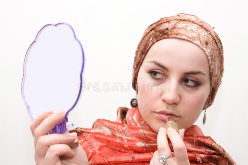 Carmín de la mujer del Islam imagen de archivo libre de regalías