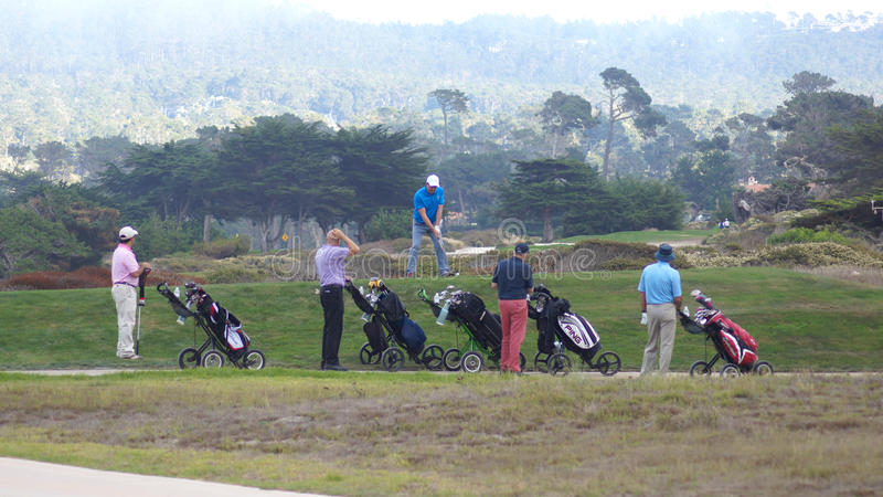 CARMEL, CALIFORNIA, UNITED STATES - OCT 6, 2014: companionship playing at the Pebble Beach Golf Course, which is part of stock photography