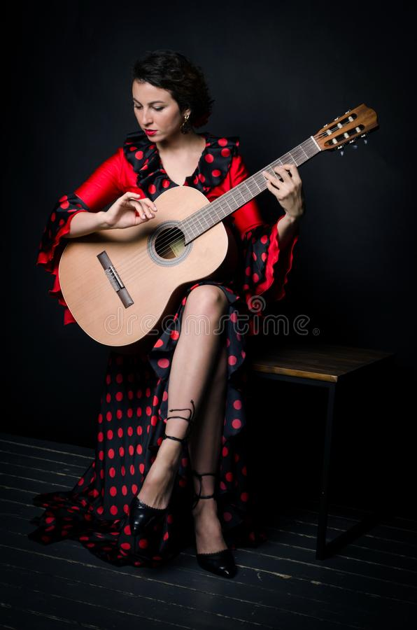 Free Carmen Beautiful Woman In Red Dress, With Guitar On Dark Background Stock Photos - 162762963