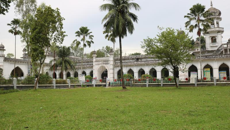Carmichael College Rangpur Administrative building in front. Old building in front garden and green grass stock photo