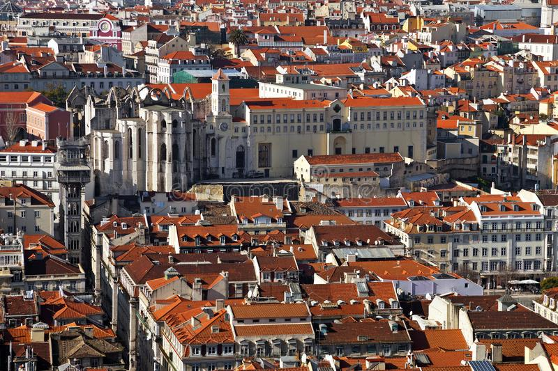 Carmo Convent ruins, Santa Justa lift or Elevator and orange rooftops. Of the historical Baixa District of Lisbon, Portugal royalty free stock photography