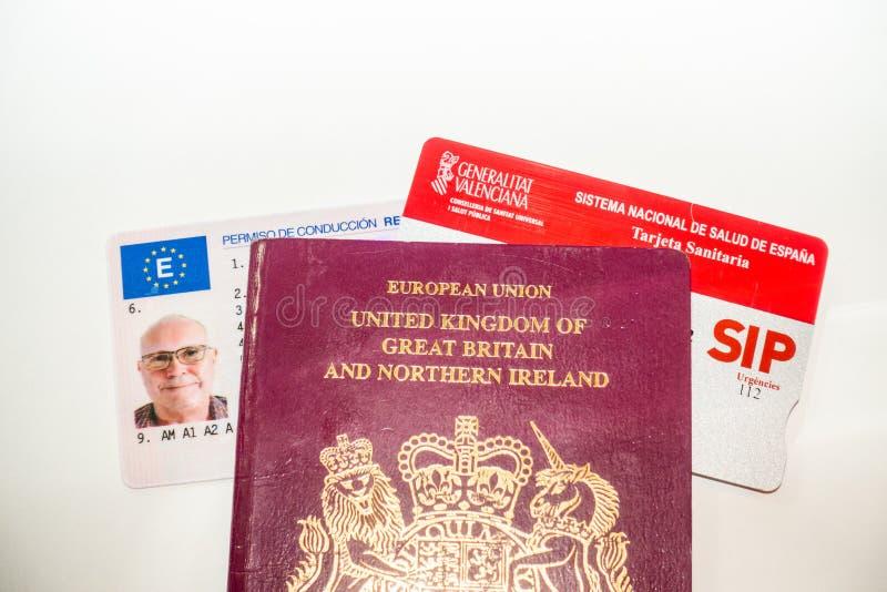 Carné de conducir, tarjeta del pasaporte y de salud imagen de archivo libre de regalías