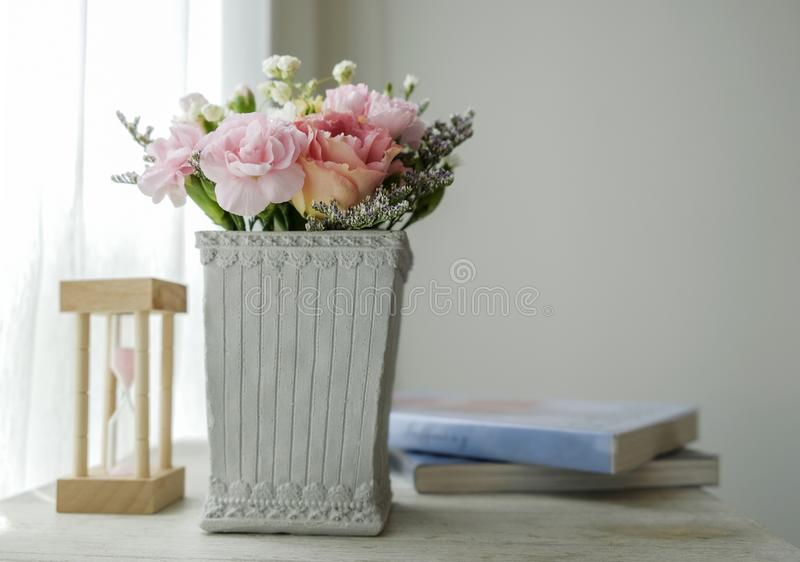 Carnation flower in cement pot on vintage cabinet at the bedroom. With copy space royalty free stock image