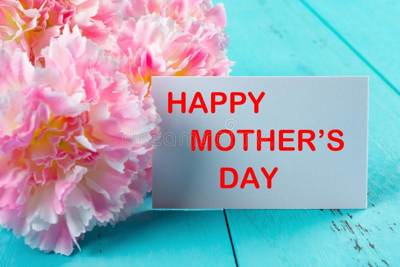 Carnations & card written with happy mothers day the removeable words inside clipping path stock images