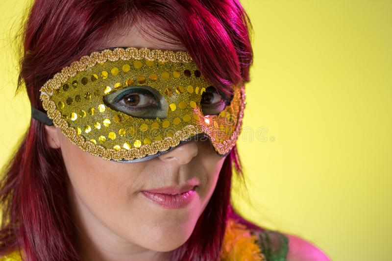Carnaval Brazil. Portrait of brazilian red hair woman with make up mask. Colorful background. Carnival concept, fun and party. Carnaval Brazil. Excited and stock photos