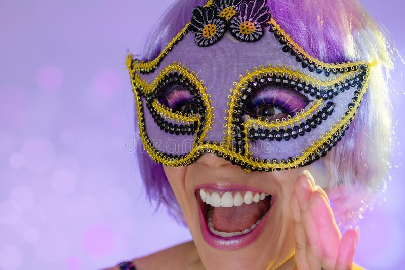Carnaval Brazil. Portrait of latin woman wearing purple wig and makeup mask. Colorful background. Carnival concept, fun and party. Carnaval Brazil. Excited and stock photos
