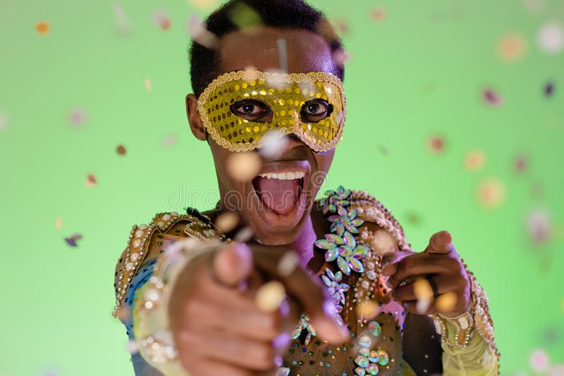 Carnaval Brazil. Throwing confetti. Colorful background. Carnival concept, funny and party. Portrait of brazilian guy dressed up stock photos