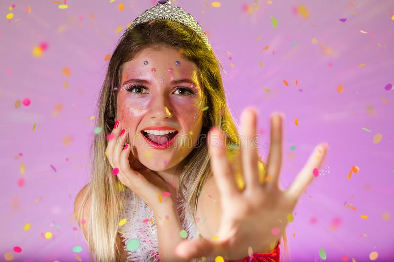 Carnaval Brazil. Throwing confetti. Portrait of brazilian woman with bright makeup. Bright background. Party concept, celebration. Carnaval Brazil. Excited and royalty free stock photo