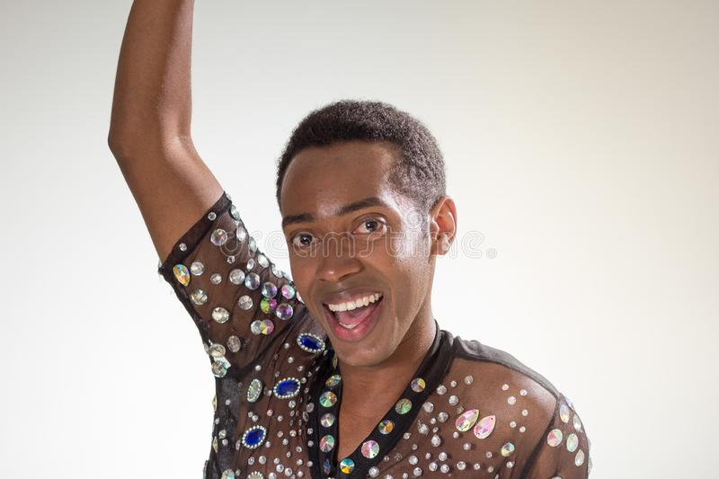Carnaval Brazil. Face of african american man wearing costume. Bright background. Party concept, celebration and festival royalty free stock photos