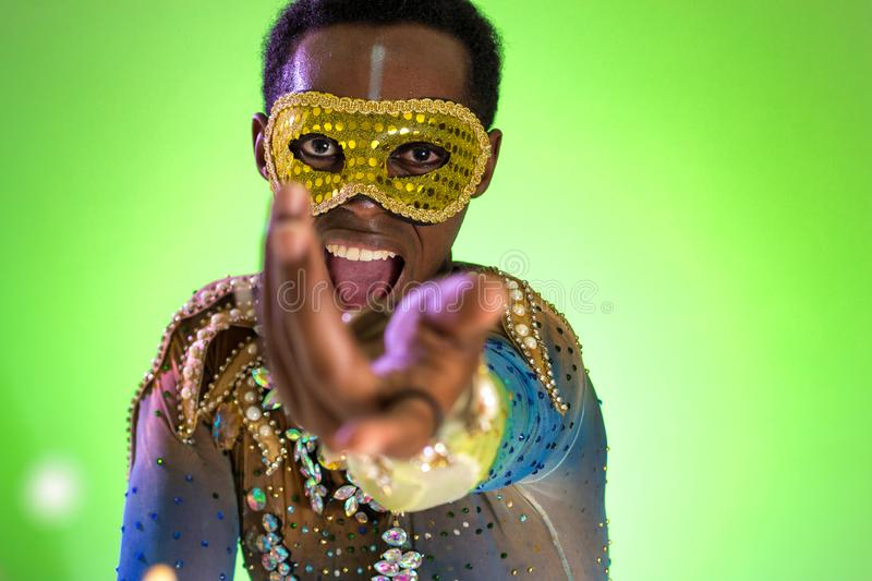 Carnaval Brazil. Face of african american man wearing costume. Bright and Colorful. Holiday concept, tradition and costume. Carnaval Brazil. Hands and gesture royalty free stock image