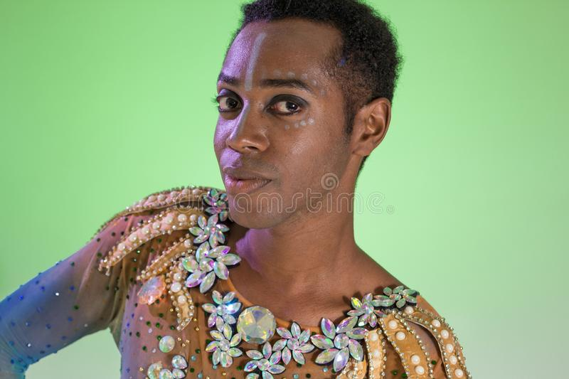 Carnaval Brazil. Face of african american man wearing costume. Bright and Colorful. Holiday concept, tradition and costume. Carnaval Brazil. Happiness and Joy royalty free stock image