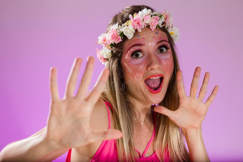Carnaval Brazil. Face of brazilian blonde woman wearing carnival costume. Bright background. Party concept, celebration and. Carnaval Brazil. Hands and gesture stock photos