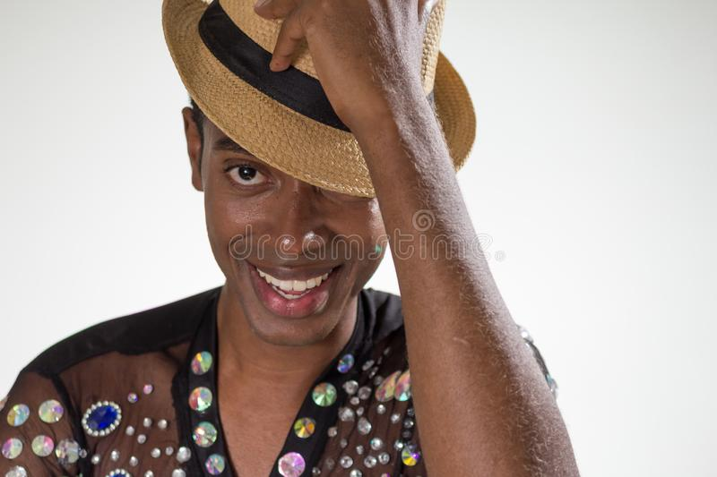 Carnaval Brazil. Face of brazilian man wearing costume. Bright background. Party concept, celebration and festival royalty free stock images