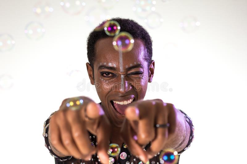 Carnaval Brazil. Face of brazilian man wearing costume. Colorful background. Carnival concept, fun and party. Carnaval Brazil. Hands and gesture. Face of stock image