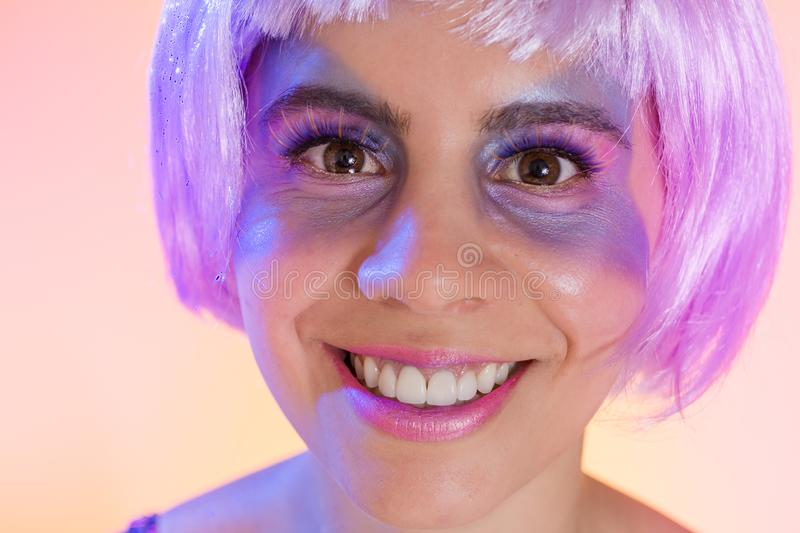 Carnaval Brazil. Face of brazilian woman with violet wig and make up mask. Bright and Colorful. Holiday concept, tradition and. Carnaval Brazil. Excited and royalty free stock photography