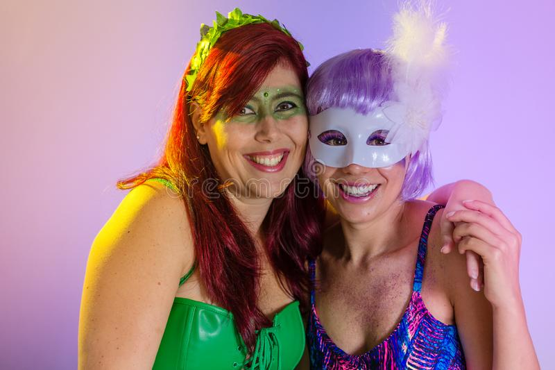 Carnaval Brazil. Face of brazilian women with violet wig and make up mask. Bright and Colorful. Holiday concept, tradition and. Carnaval Brazil. Excited and stock photo