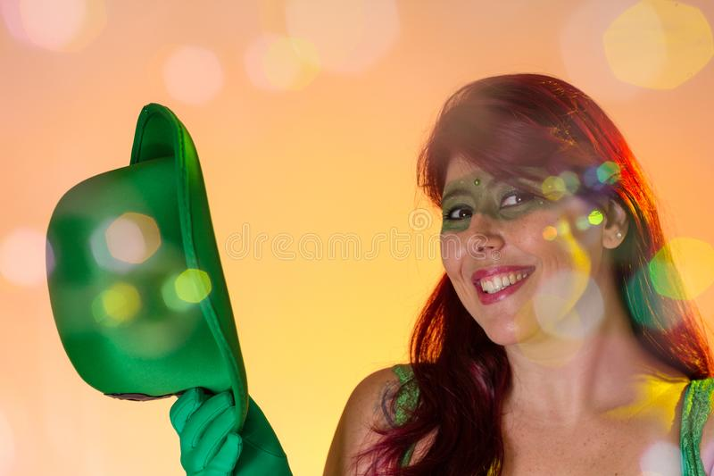 Carnaval Brazil. Face of latin redheaded girl with green make up mask. Colorful background. Carnival concept, fun and party. Carnaval Brazil. Happiness and Joy stock images