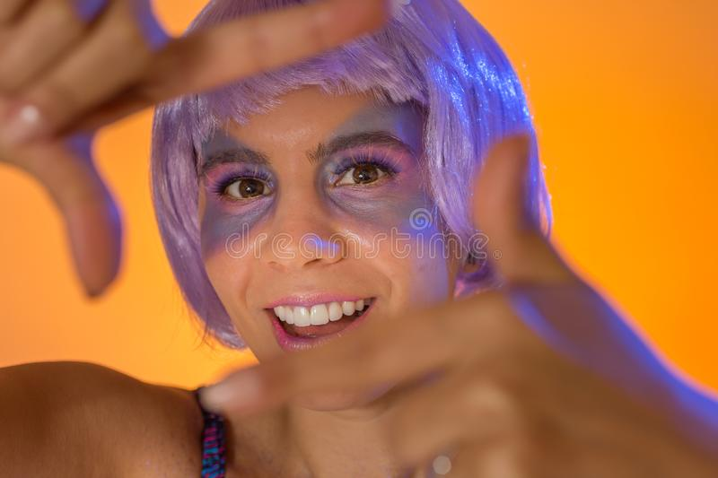 Carnaval Brazil. Face of brazilian girl wearing purple wig and makeup mask. Bright and Colorful. Holiday concept, tradition and. Carnaval Brazil. Hands and stock image