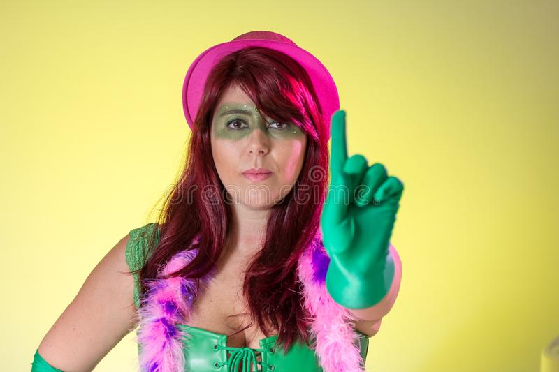 Carnaval Brazil. Hands and gesture: no harassment. Portrait of brazilian woman with green make up mask. Bright and Colorful. Carnaval Brazil. Hands and gesture royalty free stock images