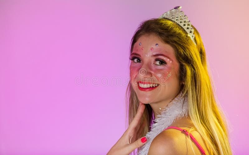 Carnaval Brazil. Happiness and Joy. Face of brazilian blonde woman wearing carnival costume. Colorful background. Carnival concept. Fun and party stock photography