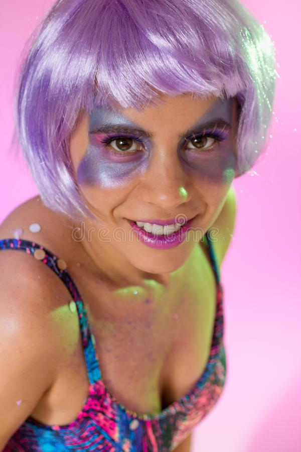 Carnaval Brazil. Face of brazilian girl wearing purple wig and makeup mask. Bright and Colorful. Holiday concept, tradition and. Carnaval Brazil. Happiness and royalty free stock photography