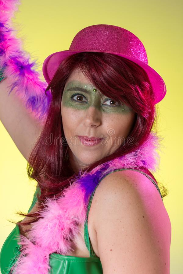 Carnaval Brazil. Portrait of brazilian red hair woman with make up mask. Colorful background. Carnival concept, fun and party. Carnaval Brazil. Happiness and stock image