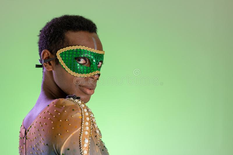 Carnaval Brazil. Masquerade black man dressed up for the holiday. Colorful background. Carnival concept, funny and party royalty free stock photo