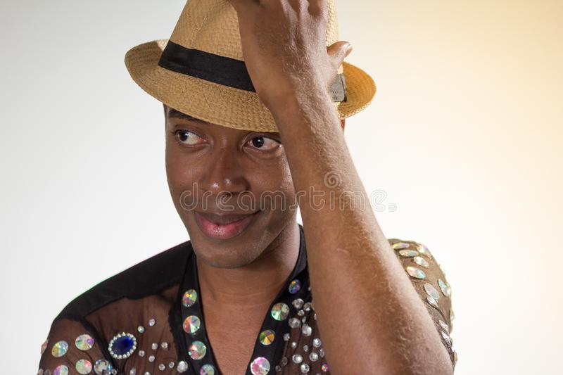 Carnaval Brazil. Portrait of black man dressed up for the holiday. Bright background. Party concept, celebration and festival royalty free stock photos