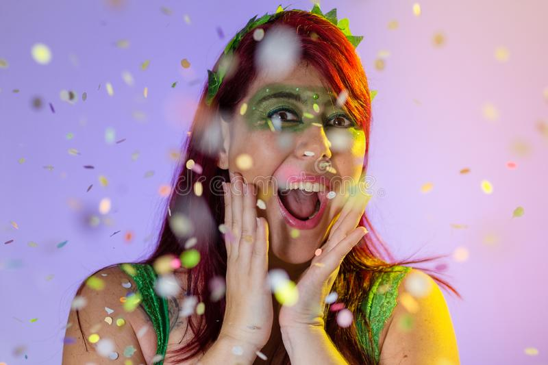 Carnaval Brazil. Surprised and excited. Portrait of redheaded girl with green make up mask. Bright and Colorful. Holiday concept,. Carnaval Brazil. Surprised and stock images