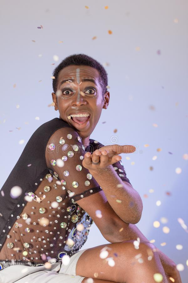 Carnaval Brazil. Surprised and excited. Portrait of black man dressed up for the holiday. Bright and Colorful. Holiday concept, royalty free stock photos
