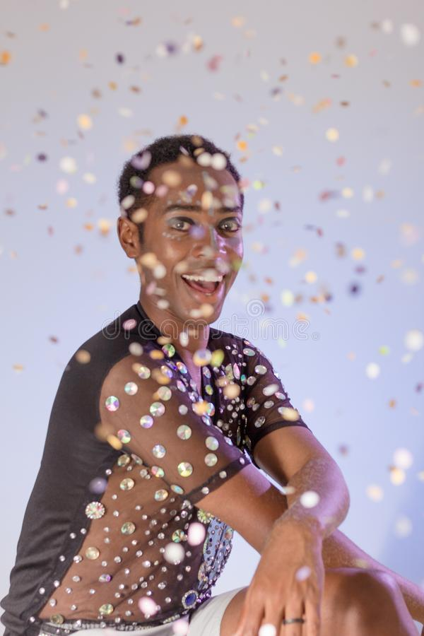 Carnaval Brazil. Throwing confetti. Bright background. Party concept, celebration and festival. Face of brazilian man wearing stock image