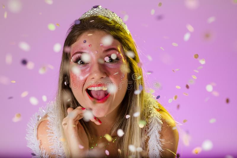 Carnaval Brazil. Throwing confetti. Portrait of brazilian woman with bright makeup. Bright and Colorful. Holiday concept,. Carnaval Brazil. Excited and Cheerful stock images