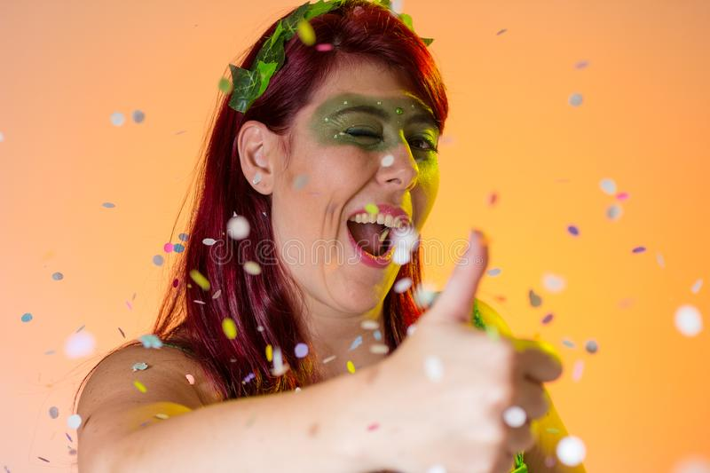 Carnaval Brazil. Thumbs up. Bright background. Masquerade concept, celebration and festival. Portrait of latin redheaded girl with. Carnaval Brazil. Hands and stock image
