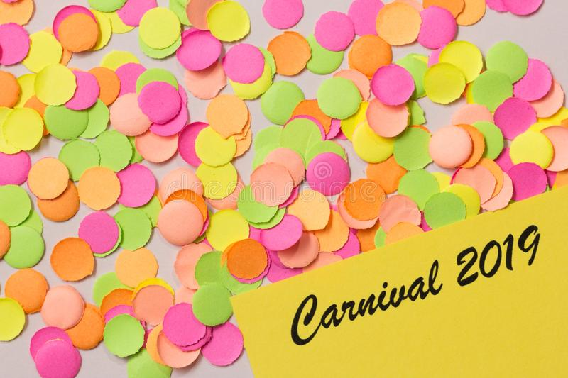 Carnaval party background concept. Space for text, copyspace. Written the words: Carnival 2019. Colorful confetti royalty free stock image
