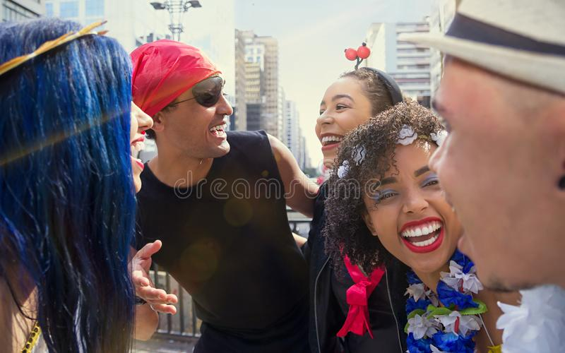 Carnaval party. Crowd of Brazil people in costume celebrating carnival in the city. Dressed partygoers having fun in parade stock photo